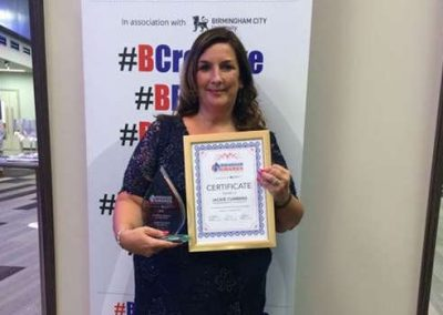 Jackie Cummins holding her award for Birmingham businesswoman of the Year 2016